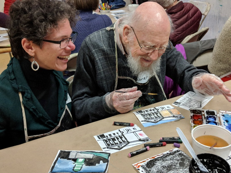 Hanna and Rainer participate in an Artful Afternoon workshop.