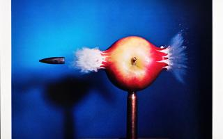 Harold Edgerton, <em> Bullet Through Apple</em>, 1964 (printed in 1984) Dye transfer print on paper, /240 40.8 x 50.8 cm 16.063 x 20 inches. © 2010 MIT. Courtesy of MIT.
