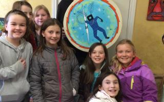 Grade 5 students from Ecole acadienne de Truro visit with Alan Syliboy at his art studio. Photo by Kris Webster, AGNS